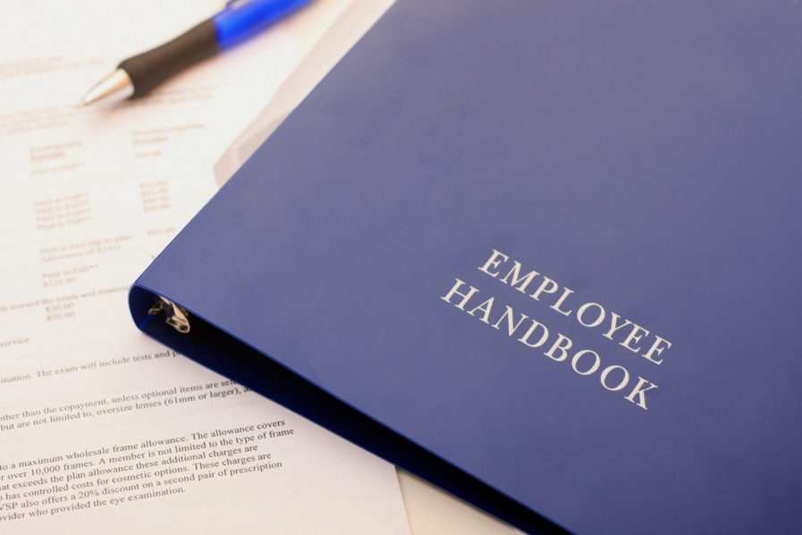 Handbook and paperwork for the newly hired.