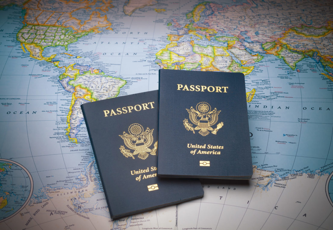 Passports on a map of the world to illustrate the keys to world travel